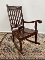 A Hardwood and brass inlaid rocking arm chair. [80x50x40cm] Originally from Saudi Arabia.