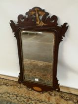 A Georgian bevel edged and giltwood trim wall mirror with a pierced and carved wood extension to the