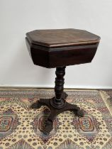 A Regency Mahogany Teapoy, with moulded octagonal lid enclosing compartments, upon a turned column