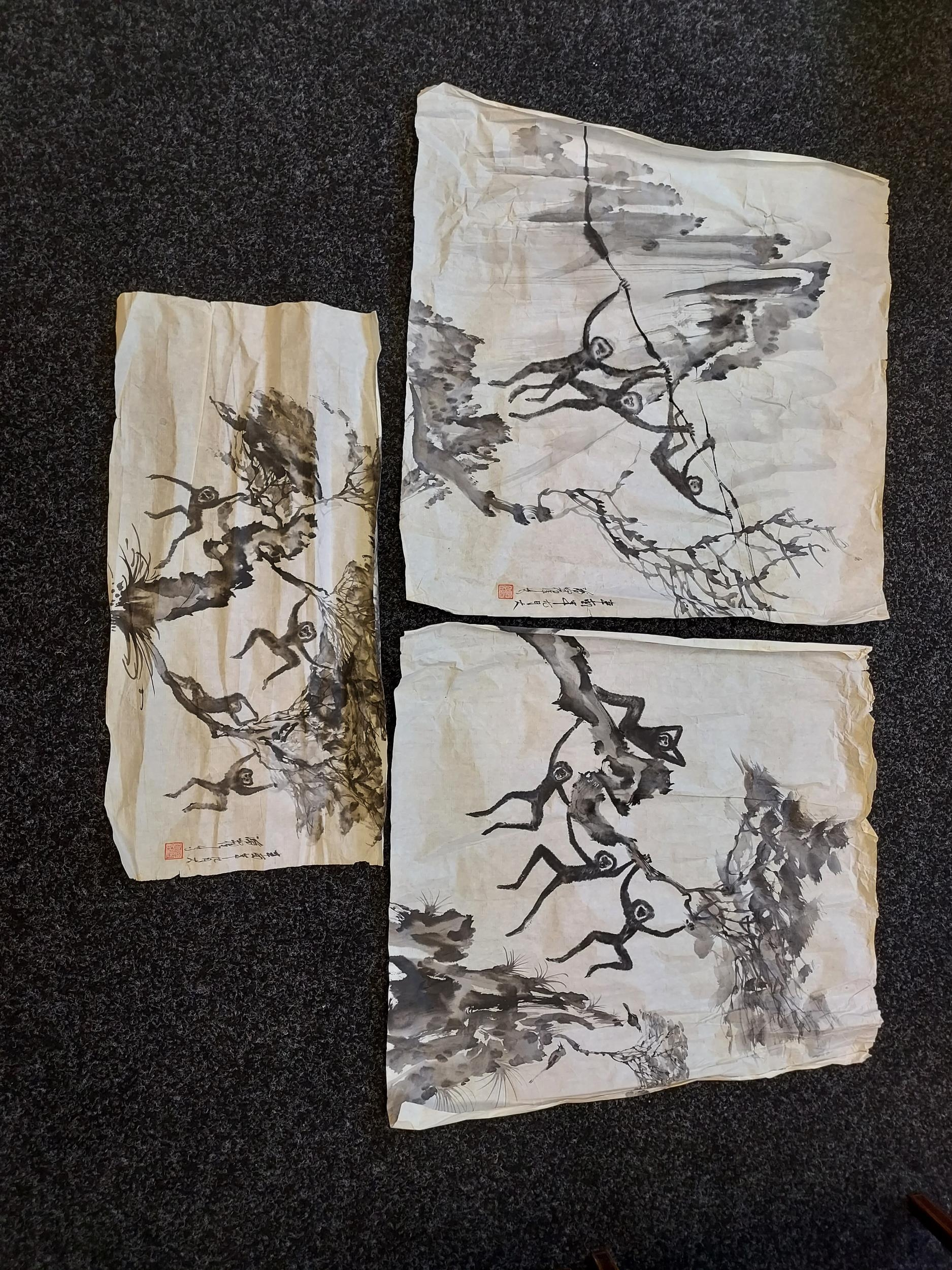 A selection of Japanese ink wash paintings depicting various monkey figures [signed by artist]