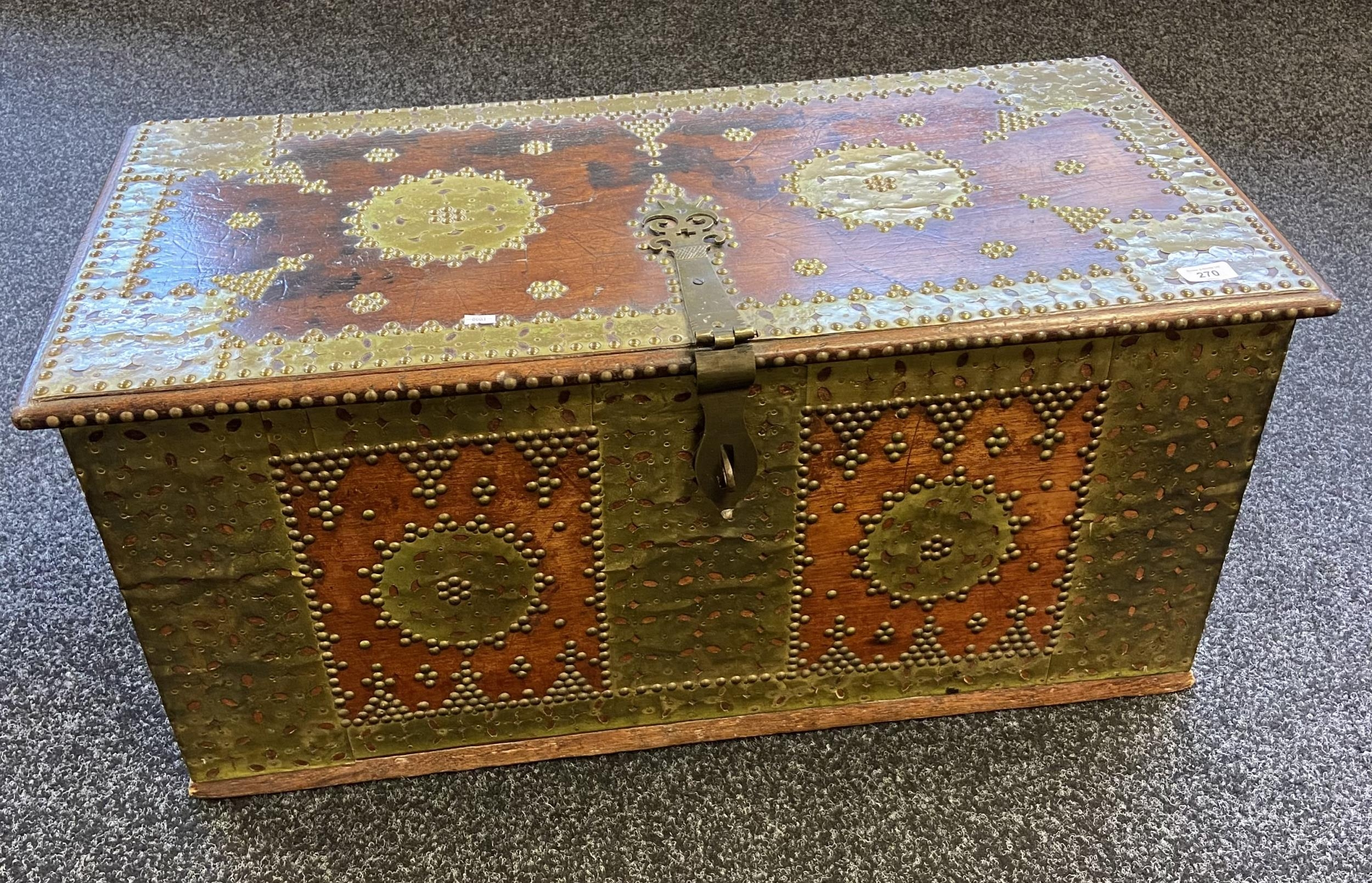 An 18th/ 19th century Arabic travel chest, Designed with brass mounts and heavy brass lock and