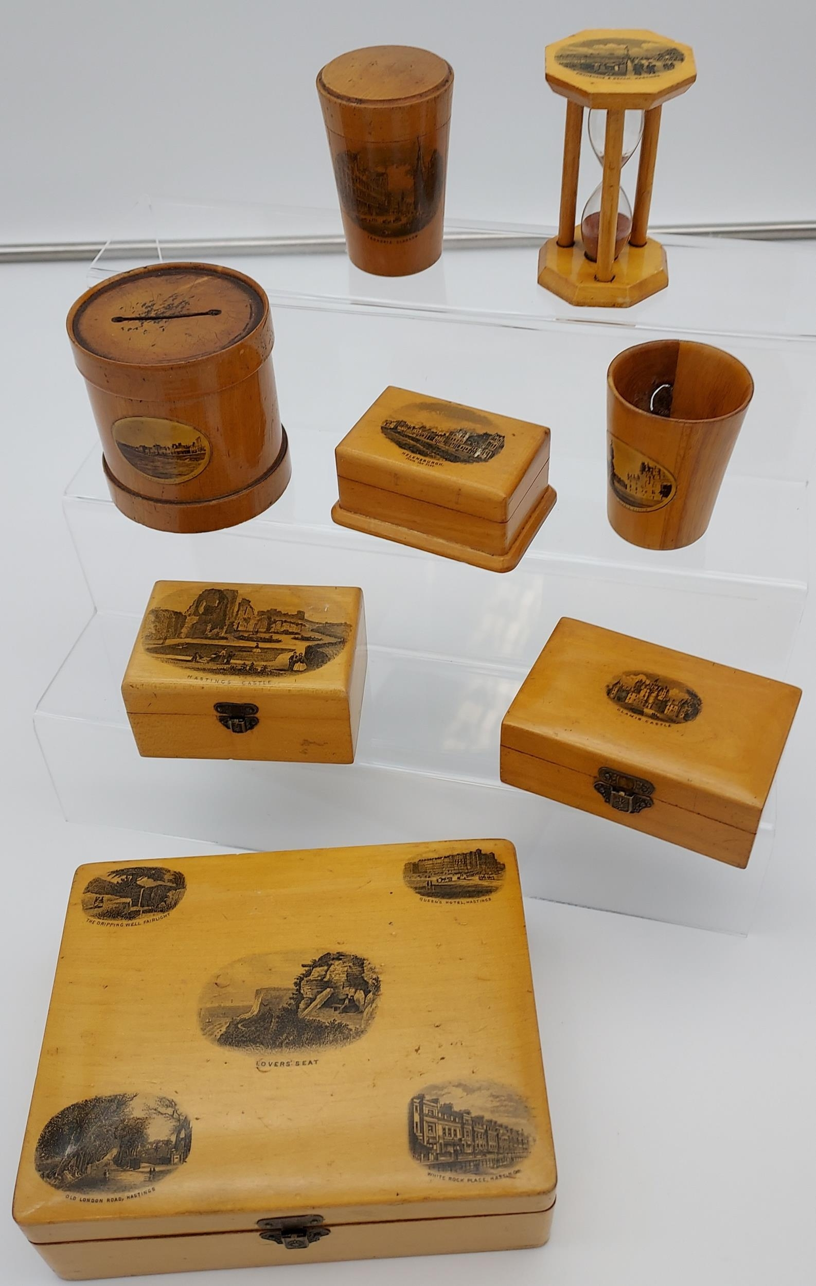 A Lot of 8 pieces of Mauchline ware to include Egg timer, money box, trinket boxes and shot glass