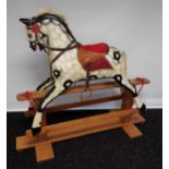 A 19th century wood and hand painted rocking horse, fitted with horse hair main and tail. [118cm