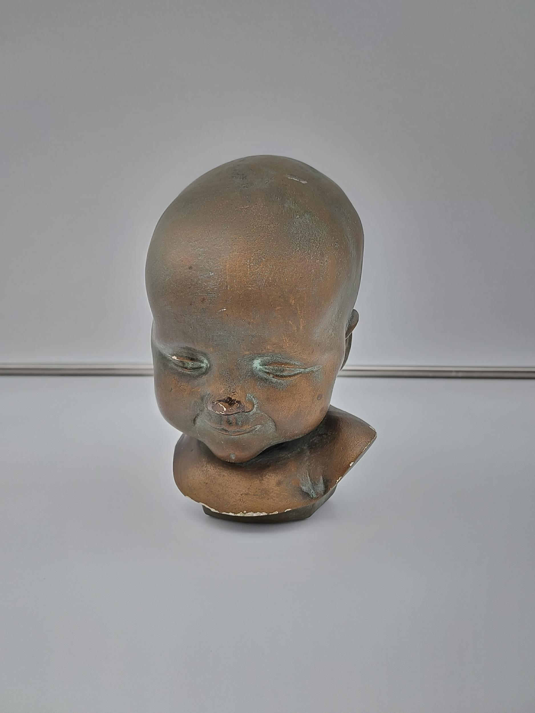 An antique chalk bronzed bust of a baby signed Eigendom G.F.U. [17CM IN HEIGHT]