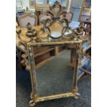 A large antique style gilt framed mirror. [120x73cm]