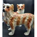 A Pair of Bo'ness pottery mantle dogs with glass eyes. [29cm in height]