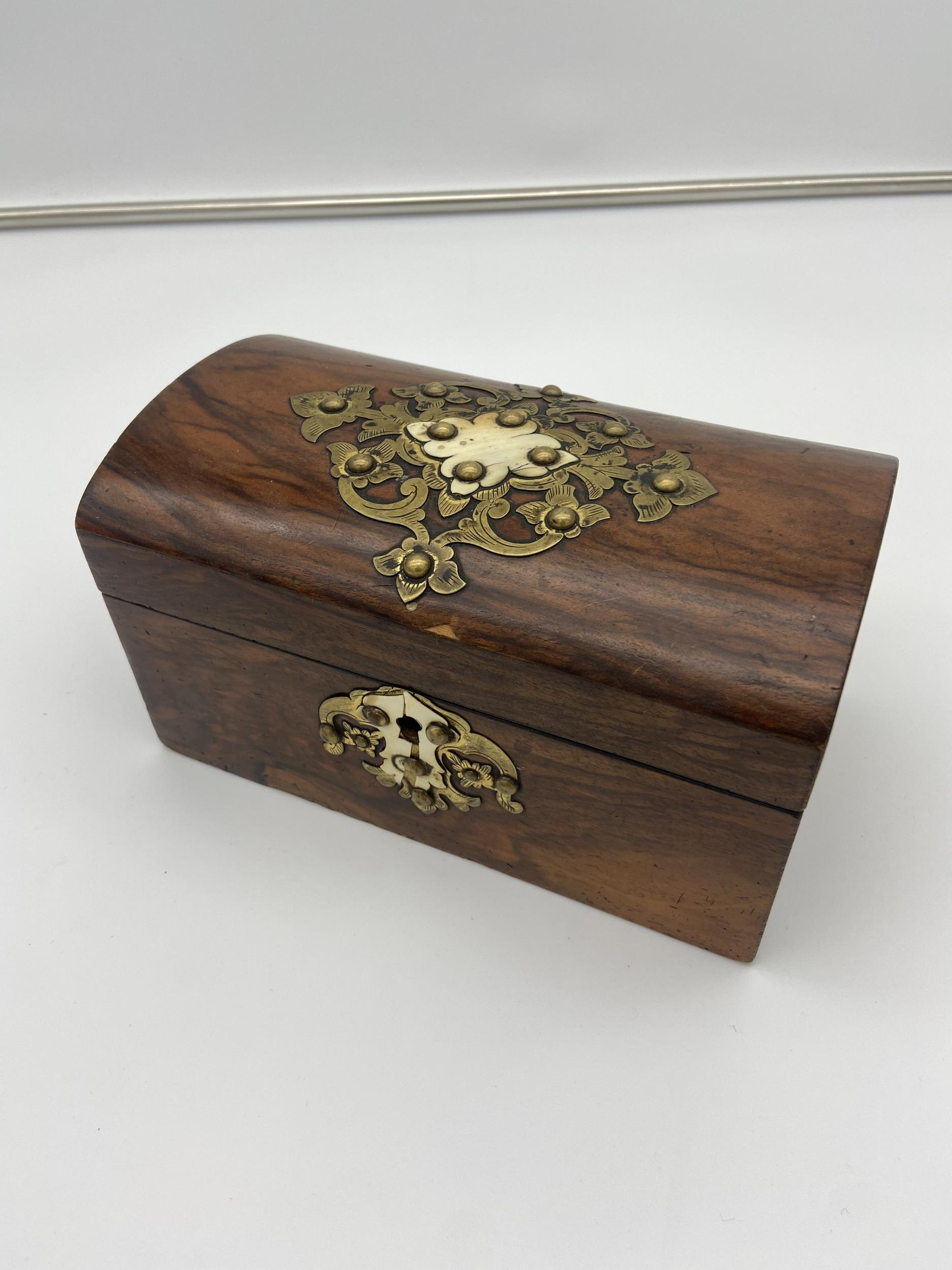 A 19th century two section tea caddy box fitted with brass mounts