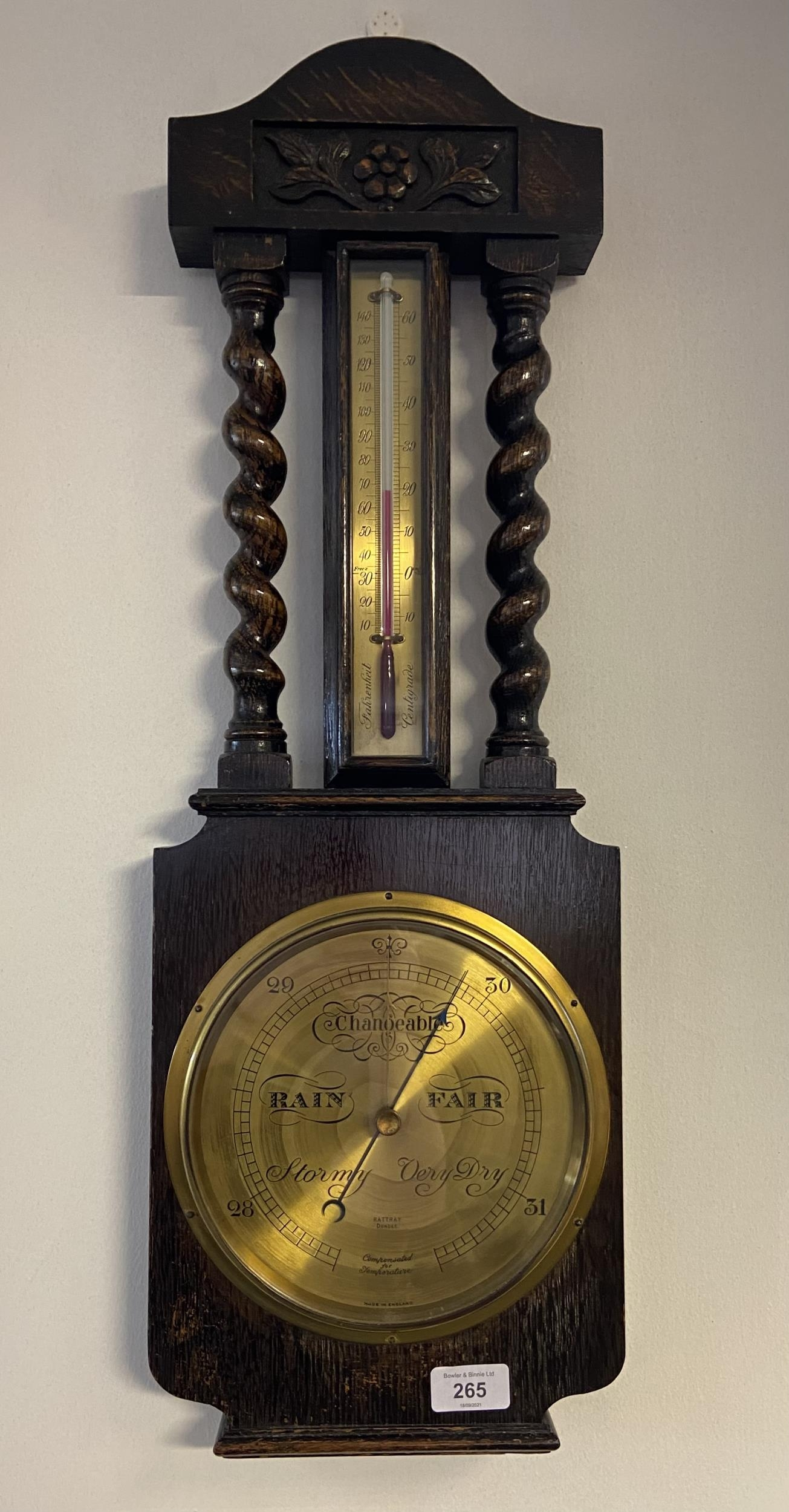 An Antique Rattray Dundee brass face wall barometer. Fitted within a dark oak body. [69cm in length]