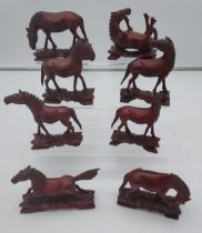 8 Chinese carved wooden horses.