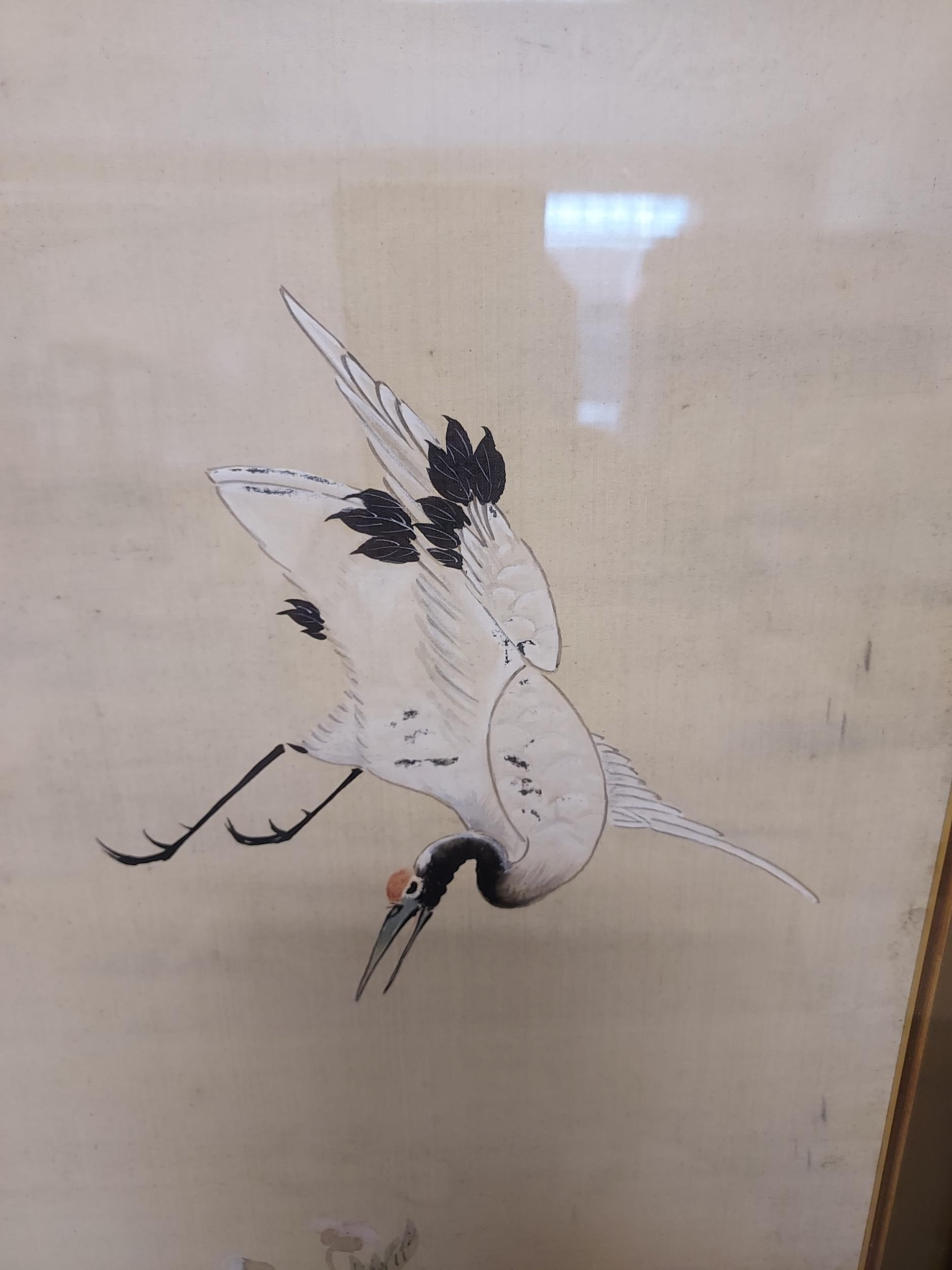 A Large 18th/ 19th century Chinese/ Japanese silk painting depicting cranes surrounded by tree and - Image 5 of 9