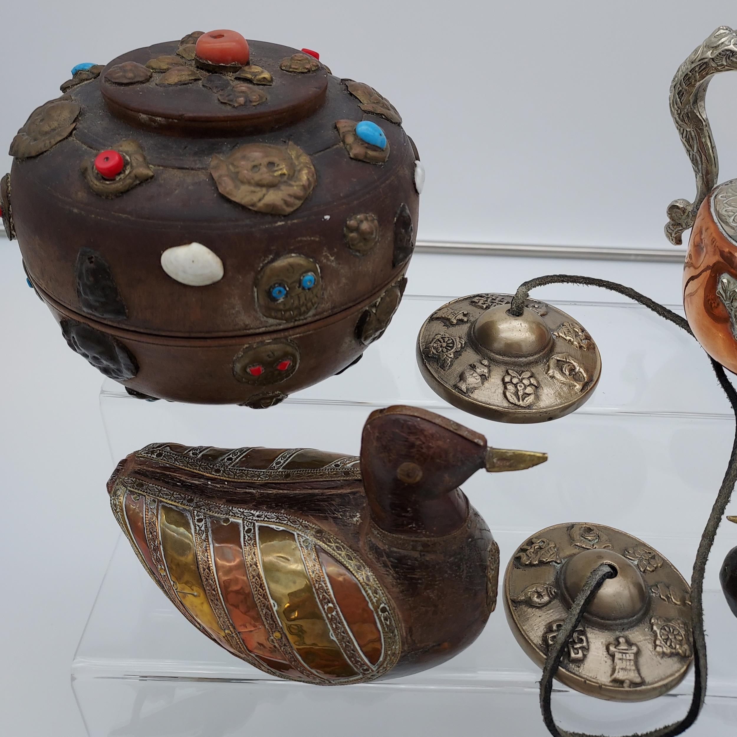 A collection of Tibetan antiques to include silver and copper teapot, prayer wheel, meditation chime - Image 3 of 6