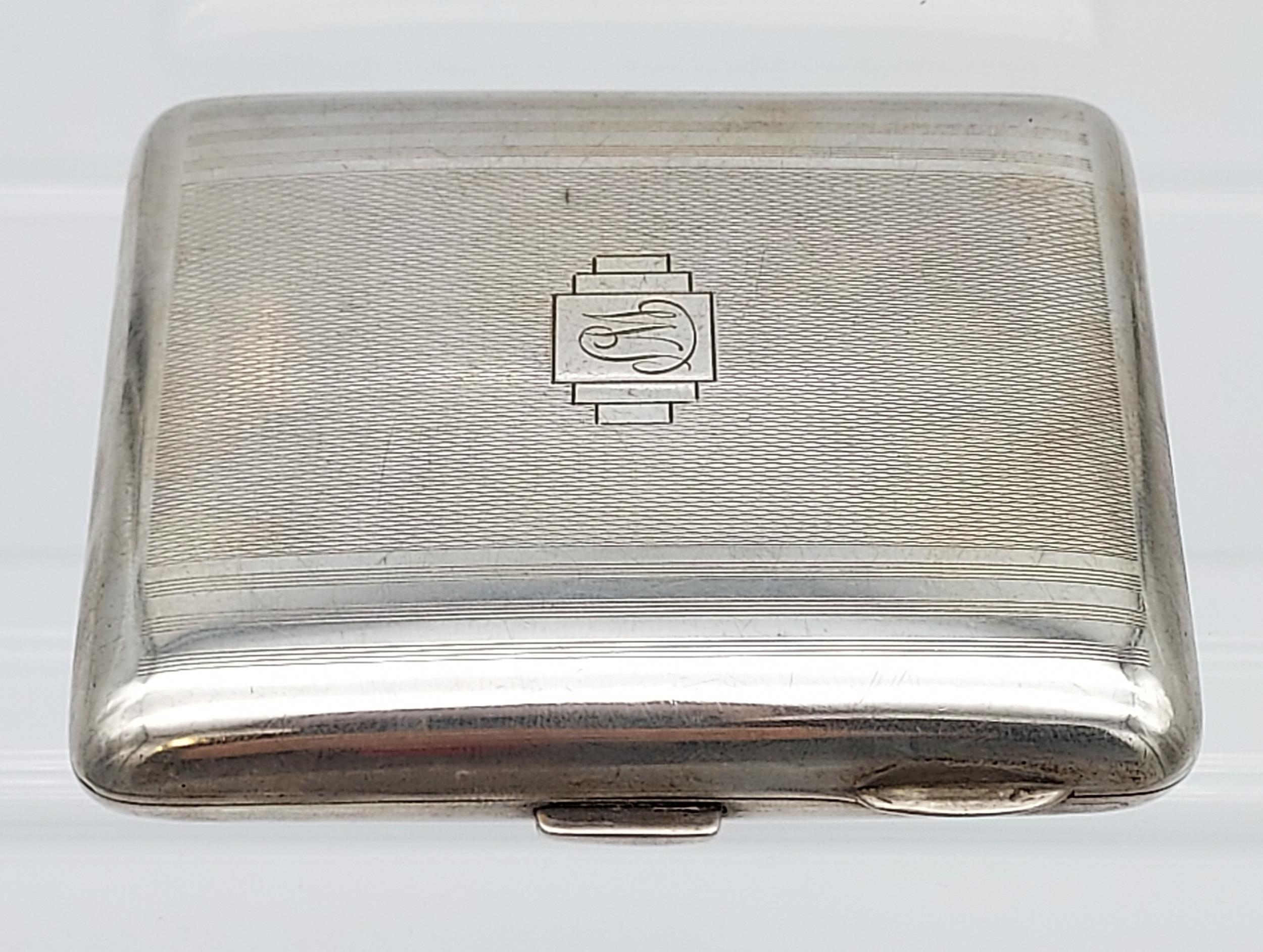 A Birmingham silver Art Deco design cigarette case [99.96grams]