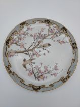 A Heavy Japanese hand painted bird and cherry blossom design plate. Eight Character signature to the