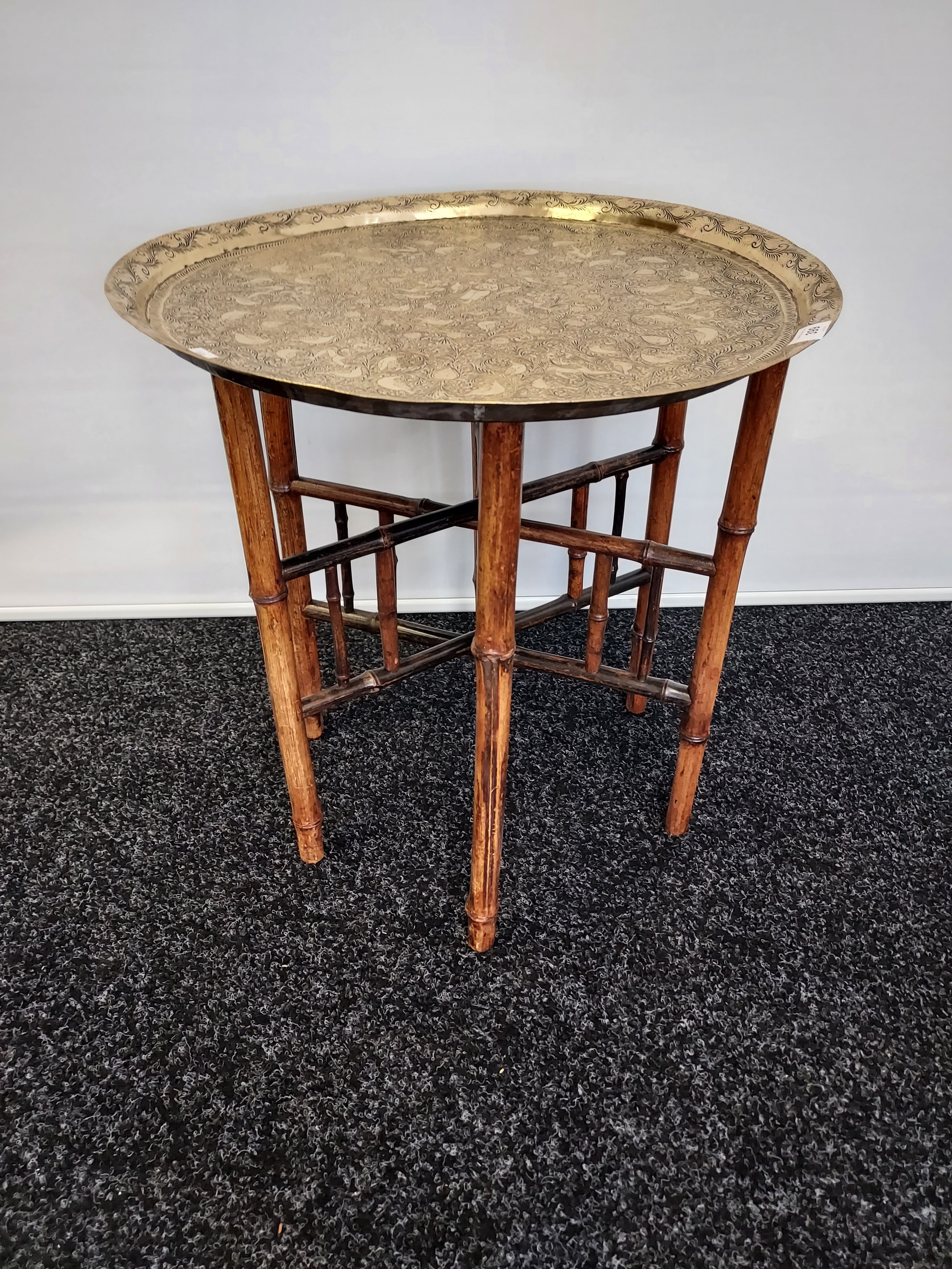 Antique Indian/ Benares decorative brass top wit folding bamboo table legs, Decoratively carved.