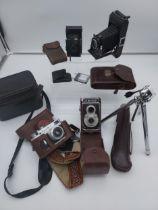 A Selection of vintage cameras to include Ensign 320 Selfix bellow camera, Kodak bellow camera,