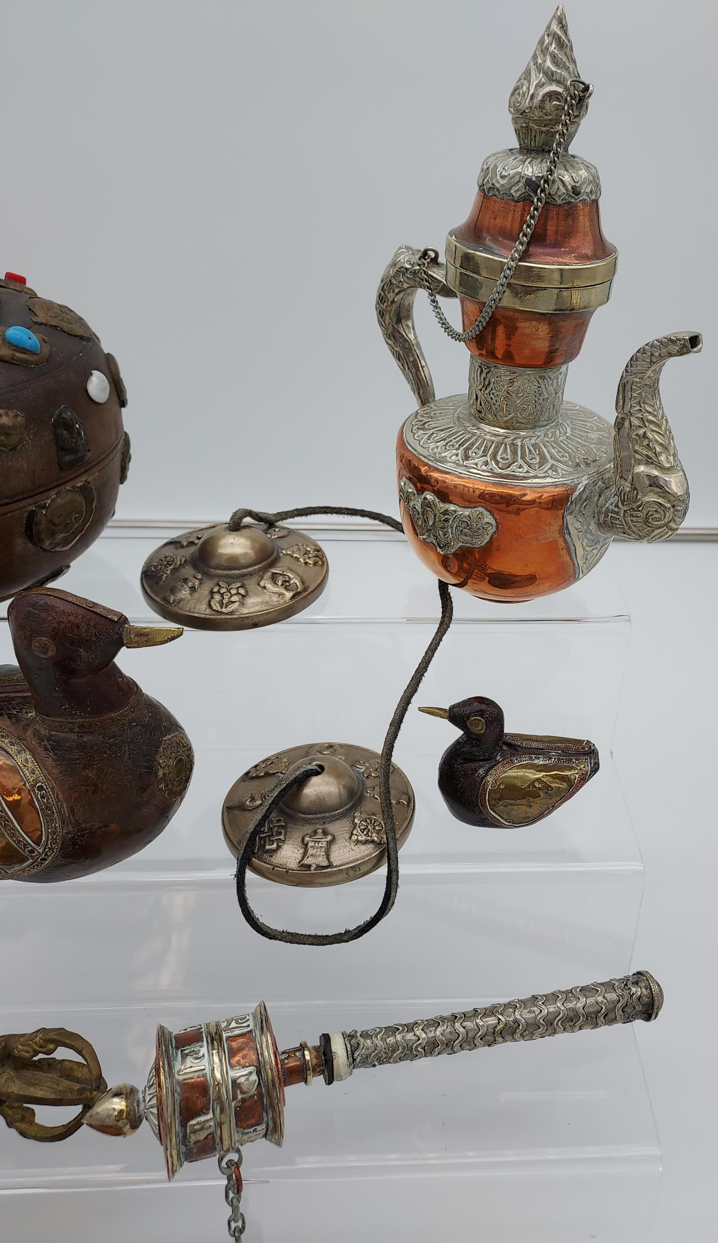 A collection of Tibetan antiques to include silver and copper teapot, prayer wheel, meditation chime - Image 4 of 6