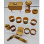 A Lot of 14 various Mauchline Ware items to include Napkin Rings, Needle holder, bank, egg timer and