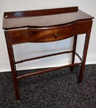 A dark wood console table, with bow front single drawer, raised on square legs, united with
