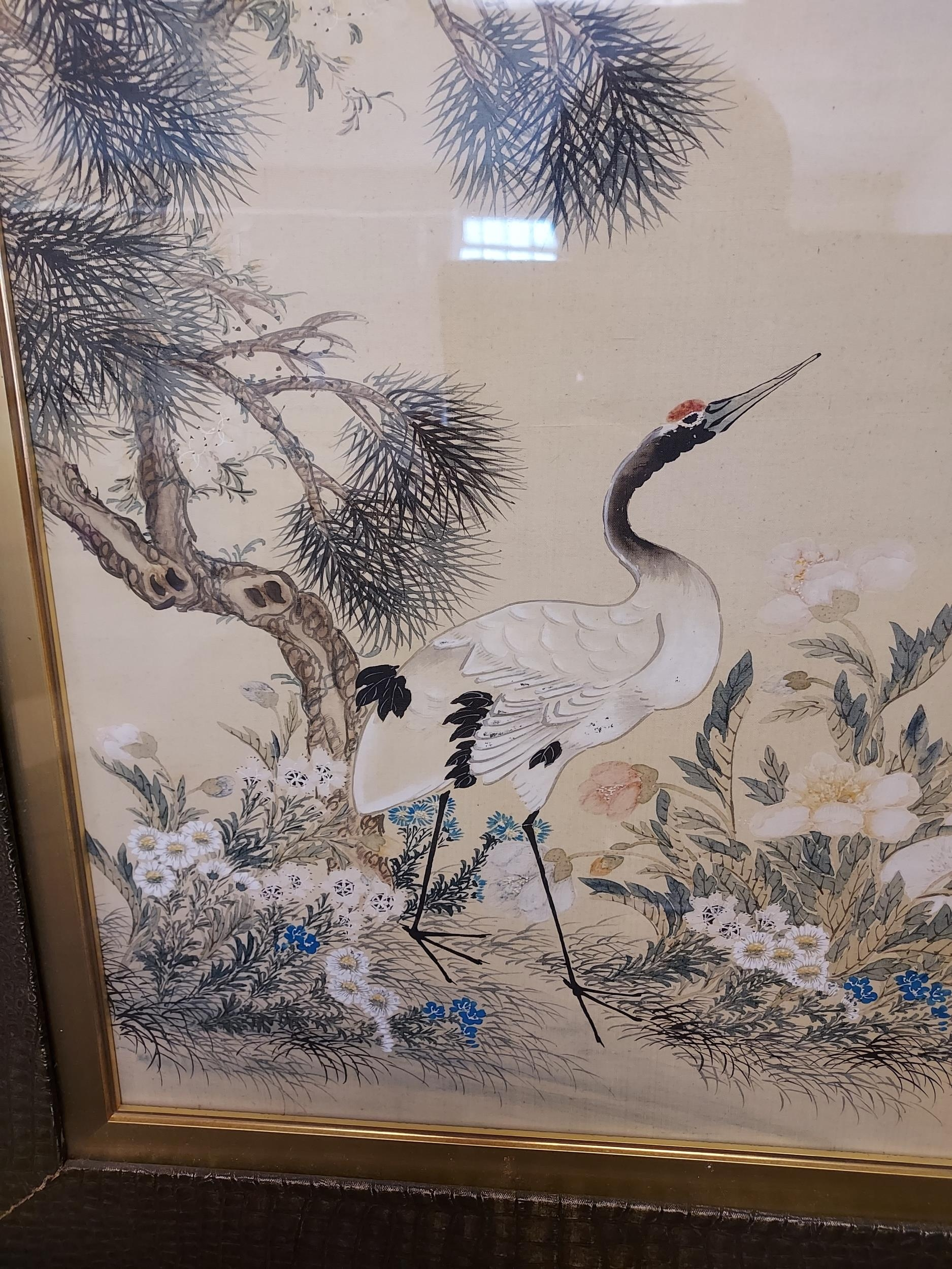 A Large 18th/ 19th century Chinese/ Japanese silk painting depicting cranes surrounded by tree and - Image 2 of 9