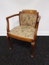 An early 20th century mahogany framed bedroom tub chair, material back support and seat flanked by