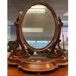 An 19th century Ornate table top dressing mirror. Has lift top compartment to the front. [