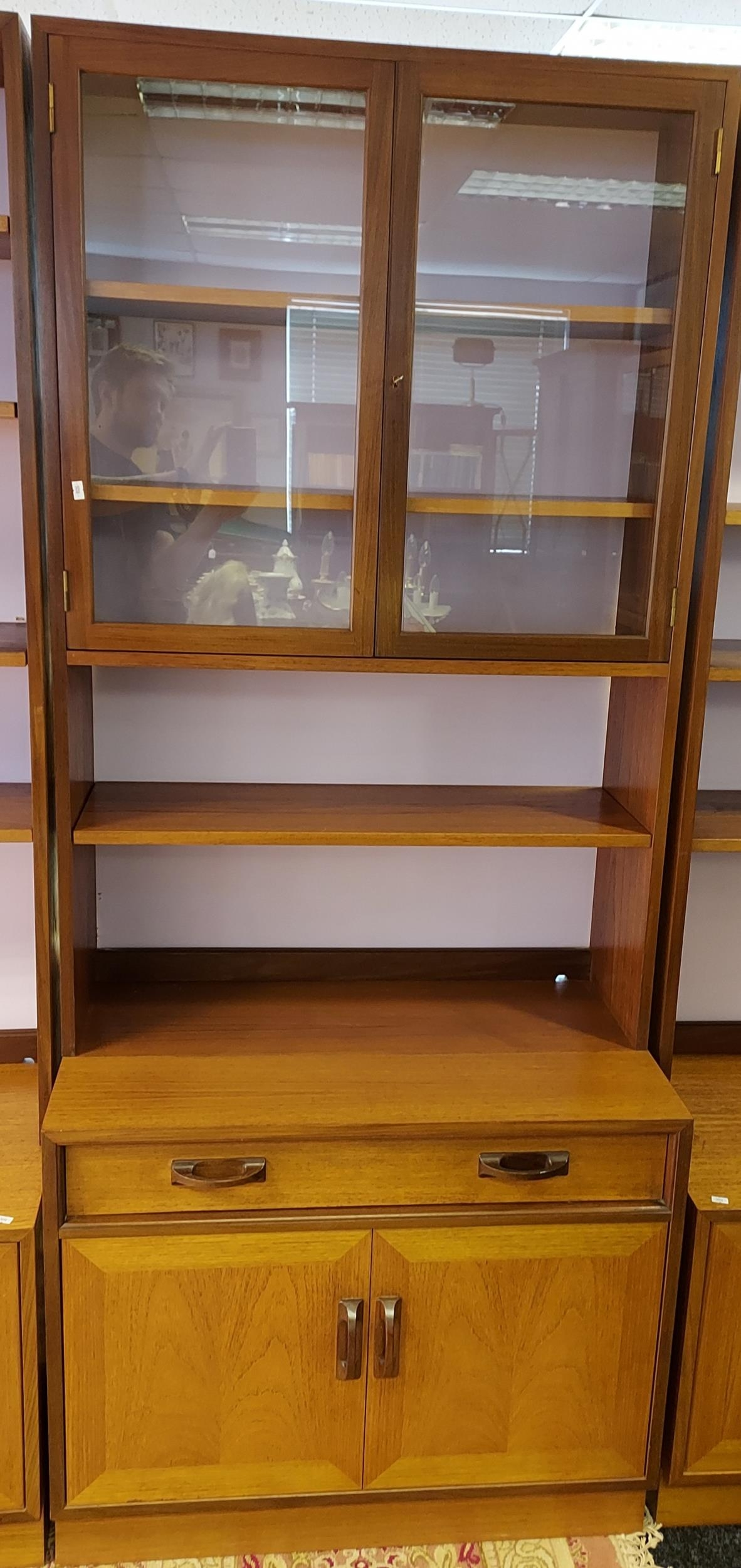 A Mid century G-Plan bookcase with two door storage area. [202x84x46cm]