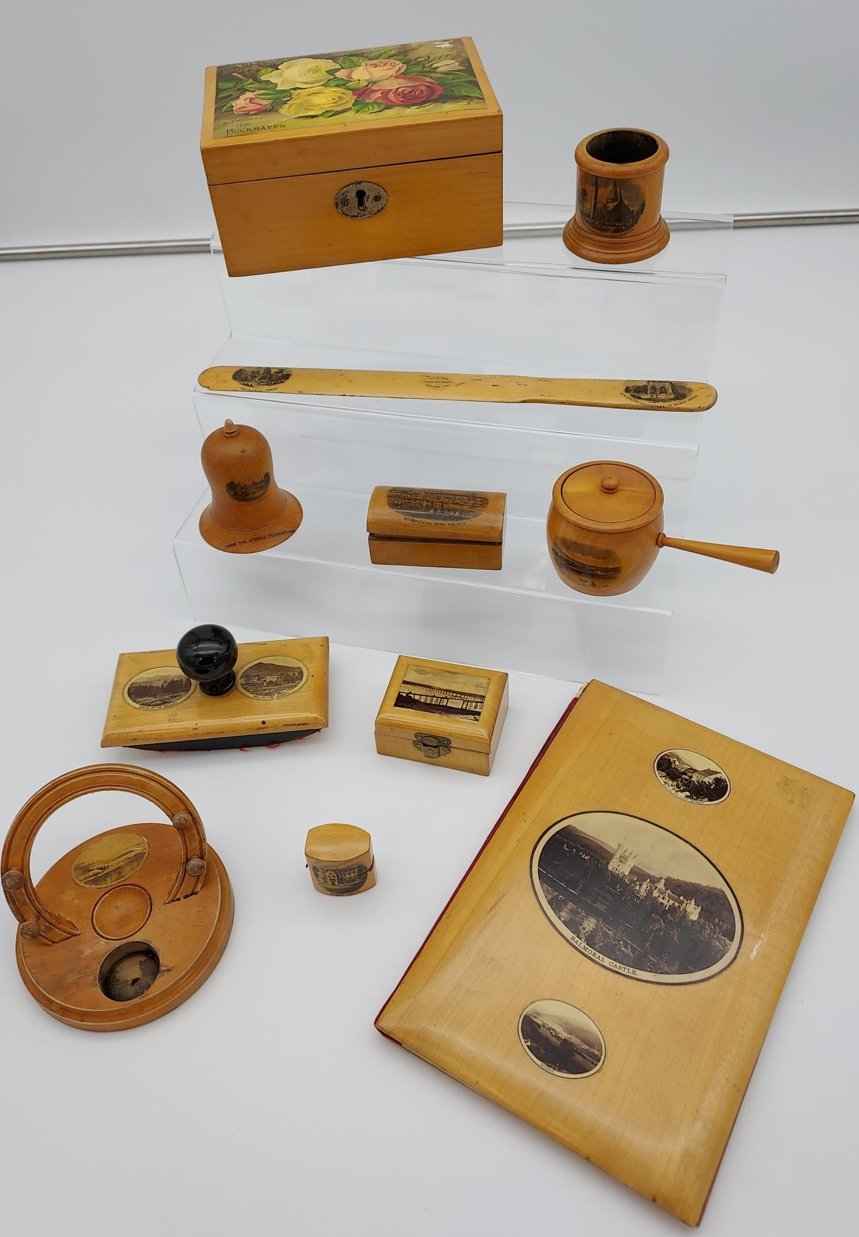 A Collection of 11 various pieces of Mauchline ware which includes Ring box, Blotter, Horse shaped