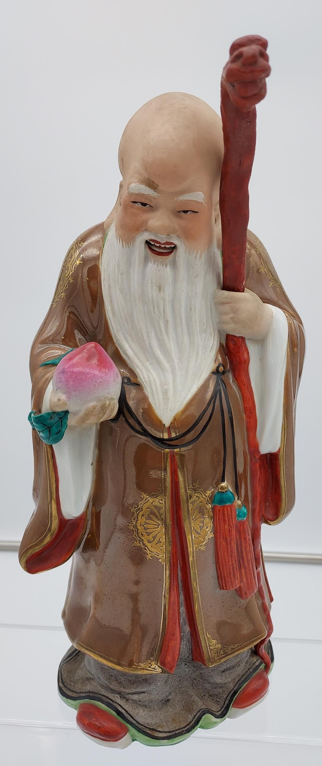 Antique Japanese hand painted god figurine with dragon head staff. Impressed mark to the base. [29cm