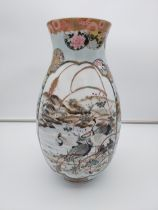 A Large Japanese hand painted panel vase, depicting various birds, flowers and village