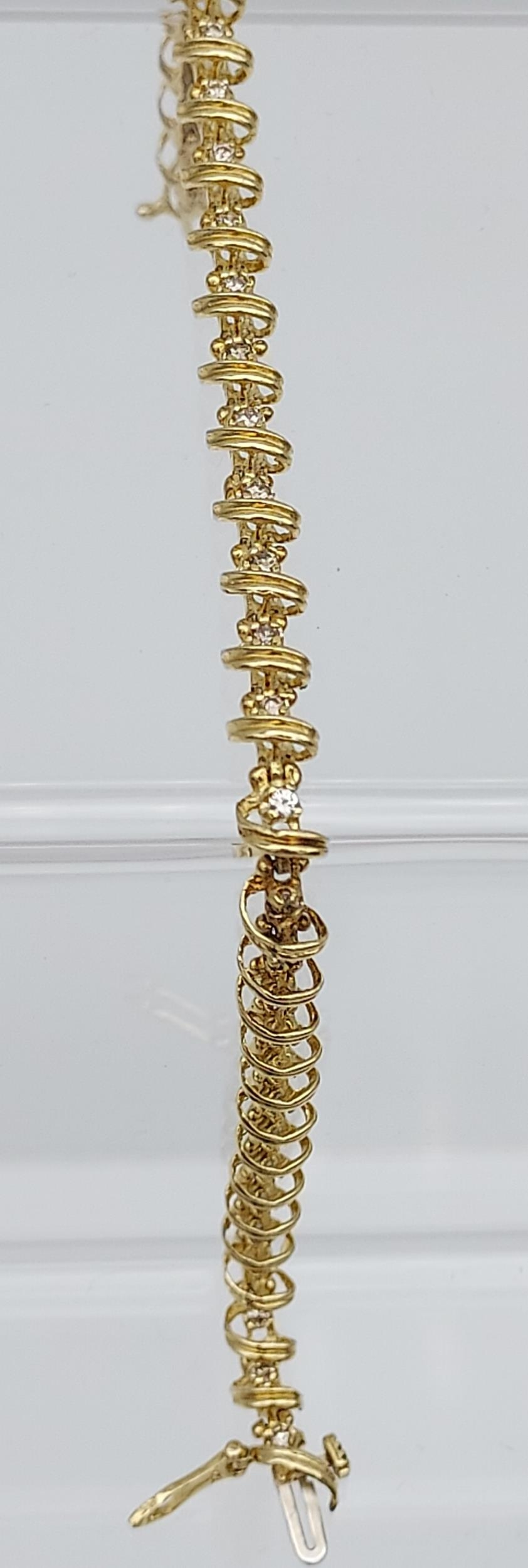 A 14ct yellow gold bracelet made up of 32 diamond panels [1ct approx] [9.58g]