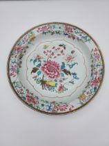 A Large 19th century Japanese wall charger. Detailed with various flowers and Butterflies. [As