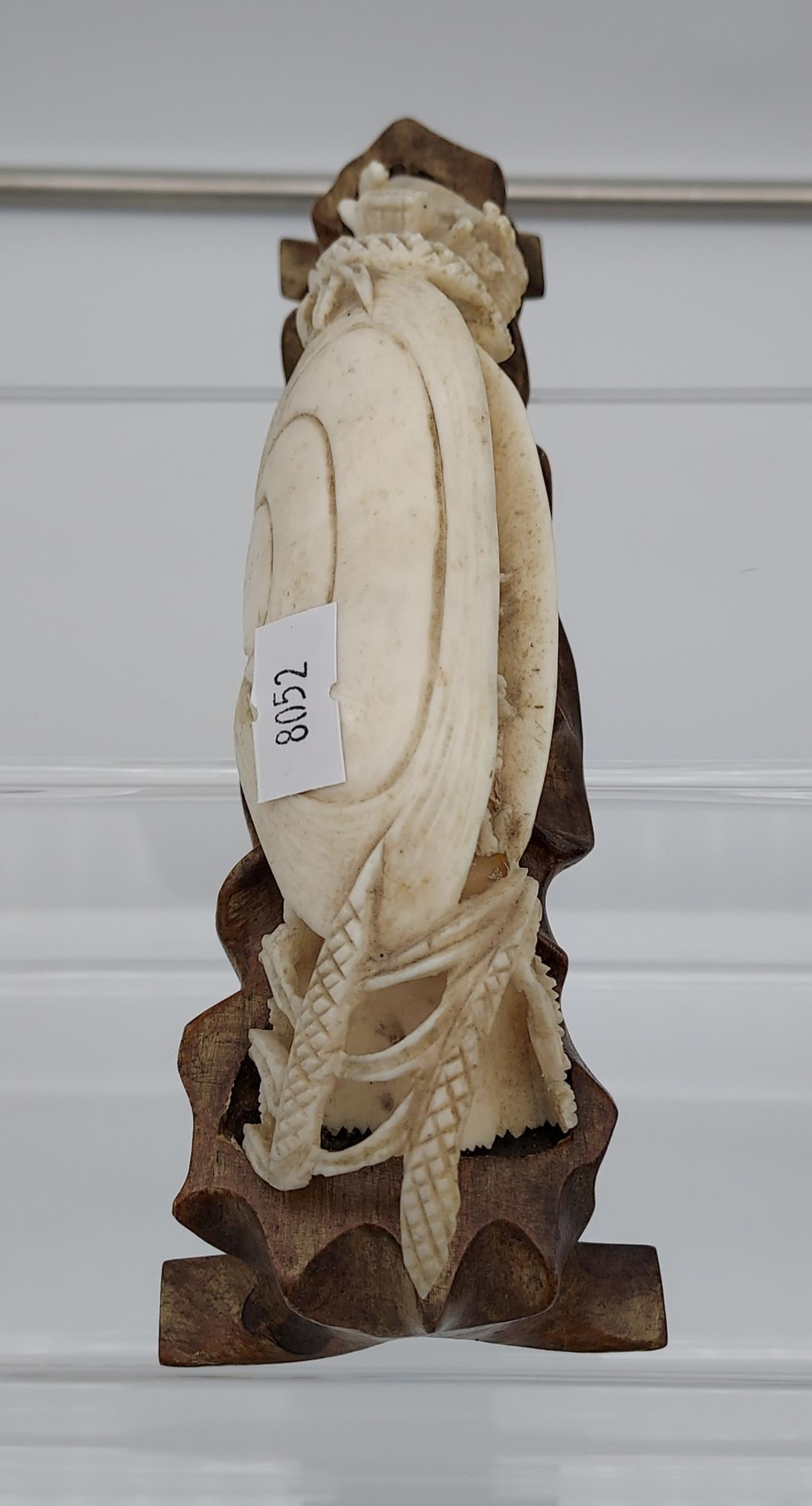 Antique Chinese hand carved ivory sculpture sat upon a carved wooden stand. [18cm in length] - Image 2 of 3