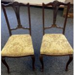 A Lot of two matching 19th century parlour chairs. Both designed with pierced splat backs and
