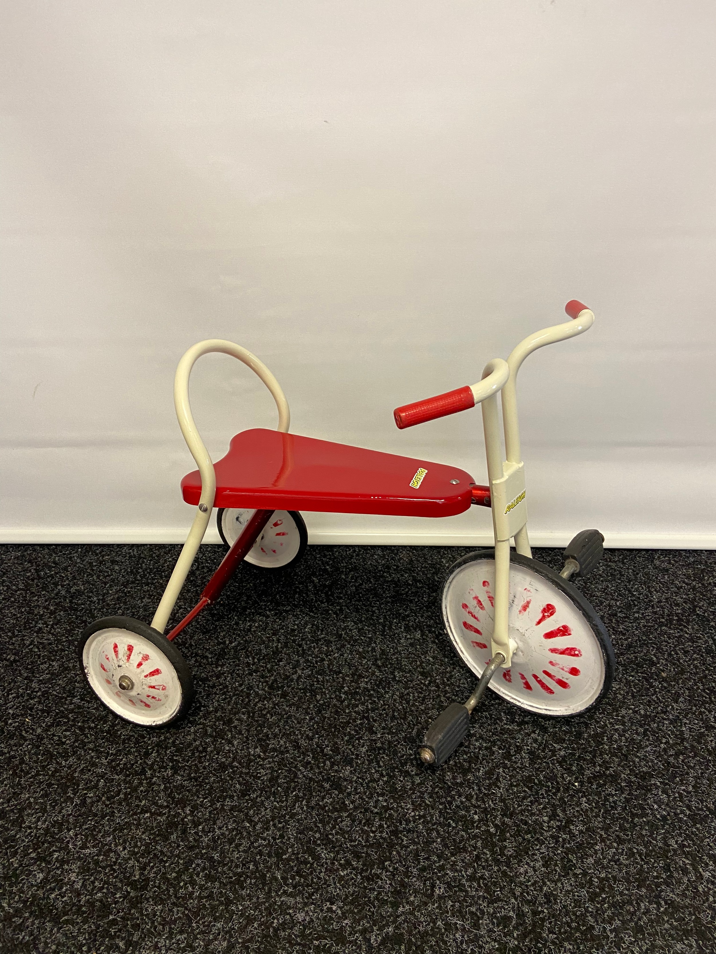A Vintage childs Raleigh tricycle.