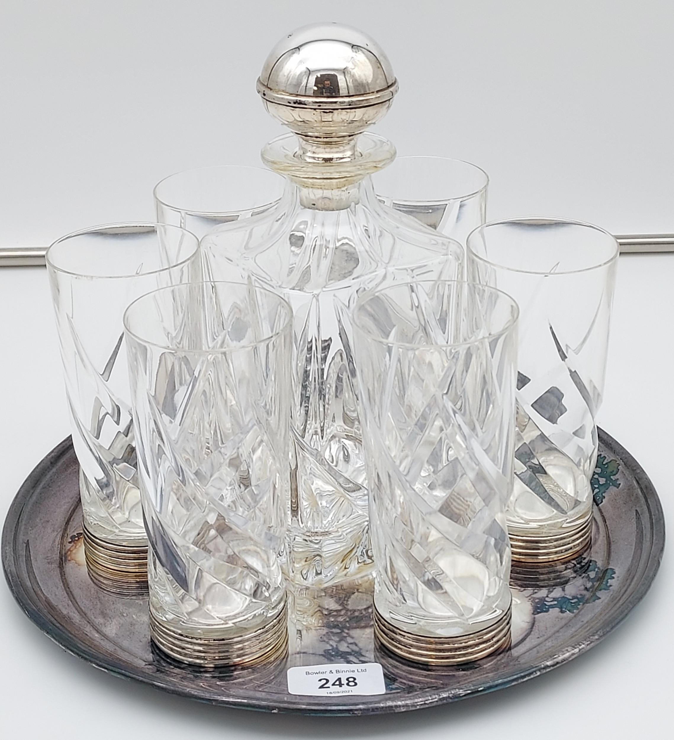 Crystal decanter with a 800 grade silver stopper, with 6 matching drinks glasses with silver