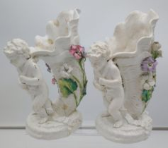A Pair of 19th century Moore Bros cherub figurine carrying a horn shell vase. [Both as found] [