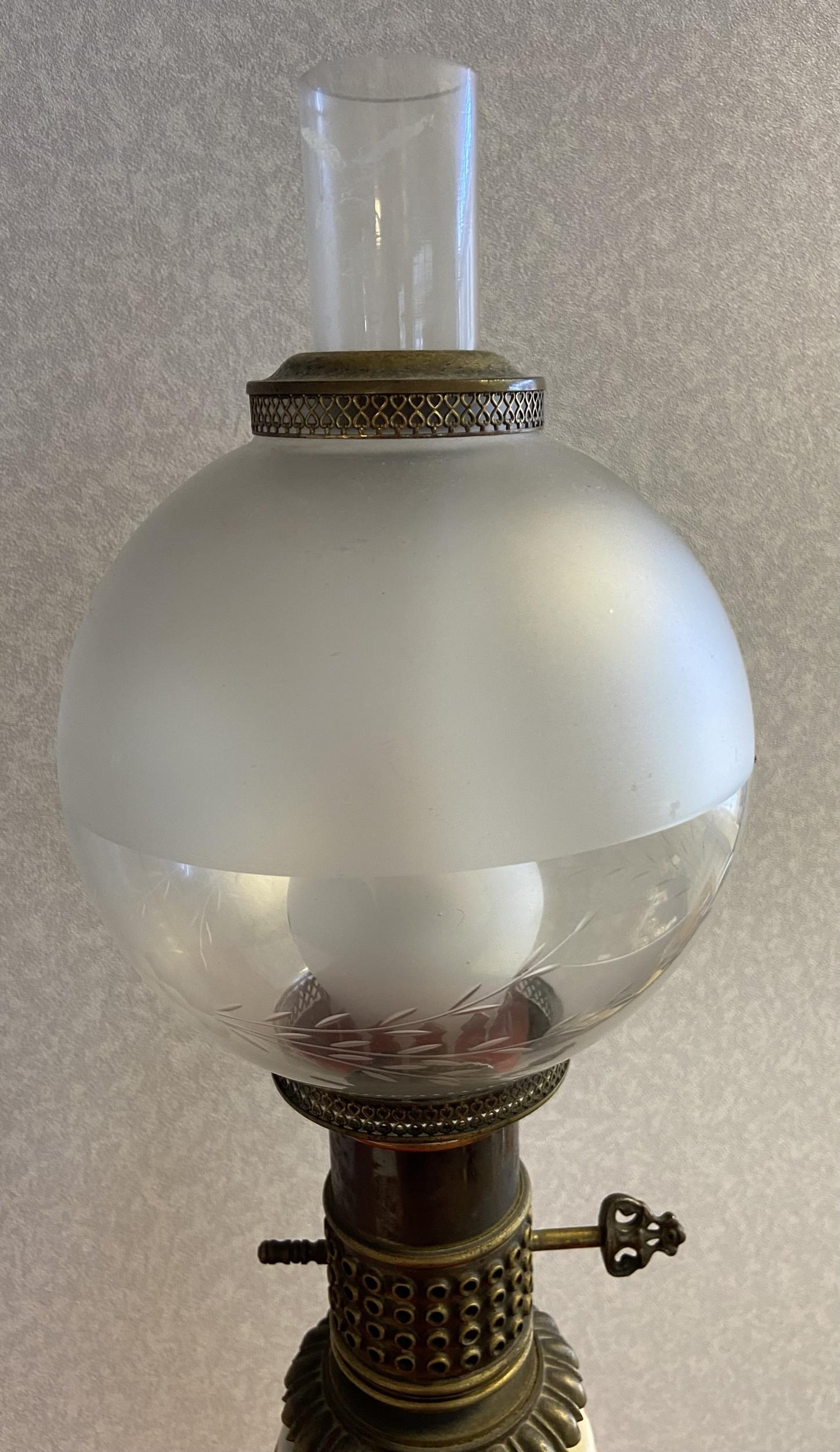 An Antique porcelain, metal and glass shade paraffin lamp converted to electric. [72cm in height] - Image 2 of 3