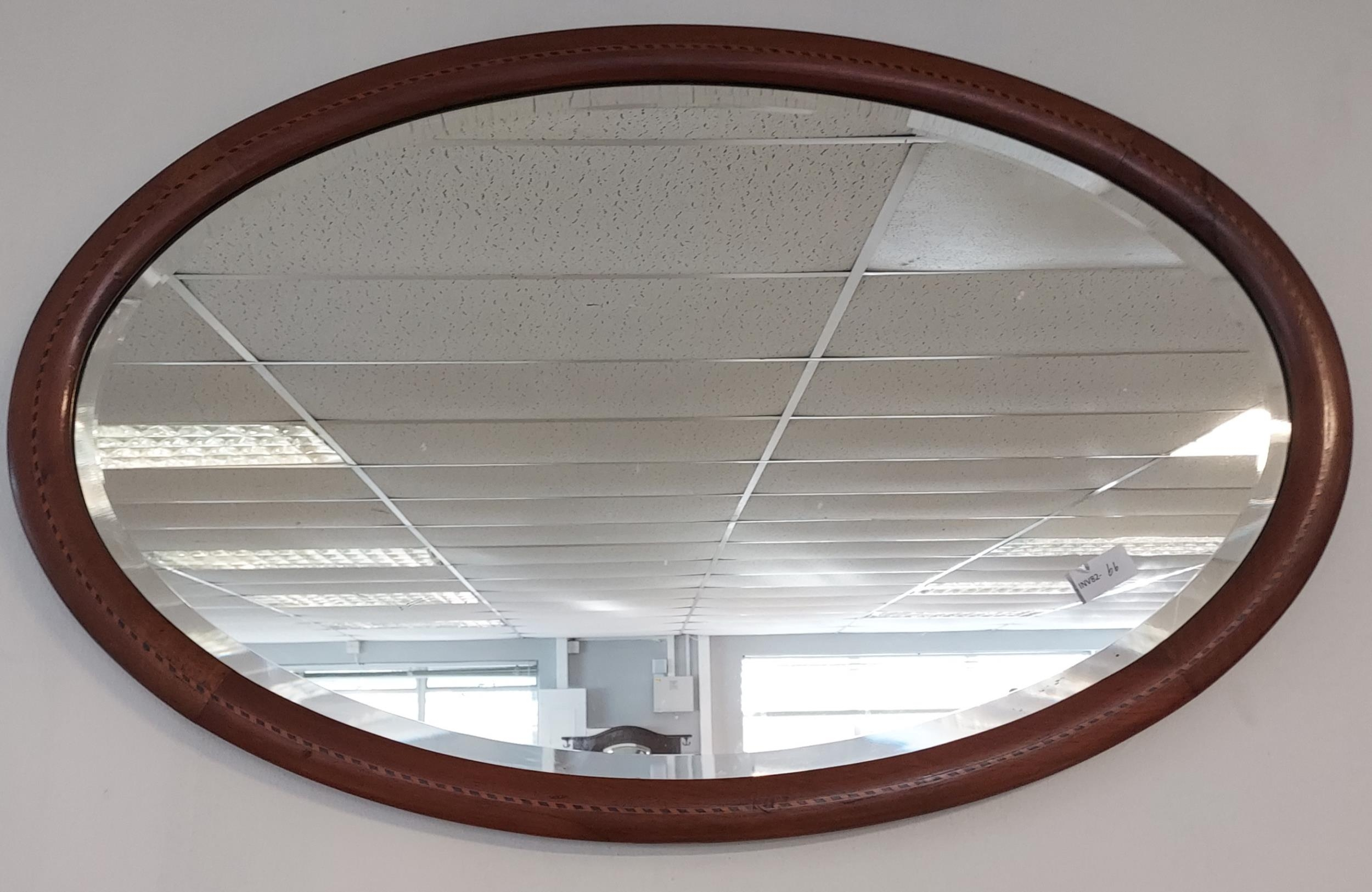 A 19th century oval mantle mirror.