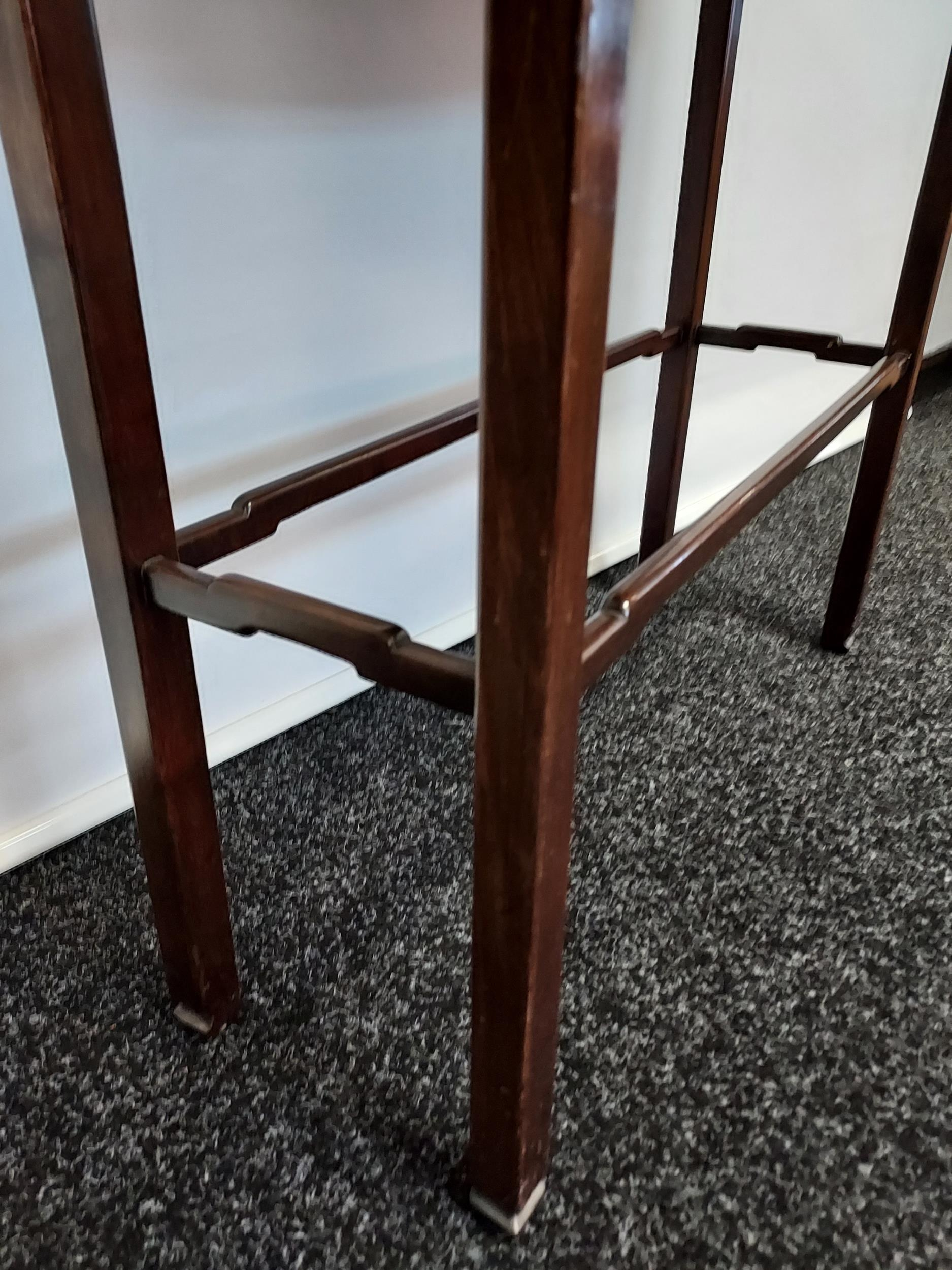A dark wood console table, with bow front single drawer, raised on square legs, united with - Image 4 of 4