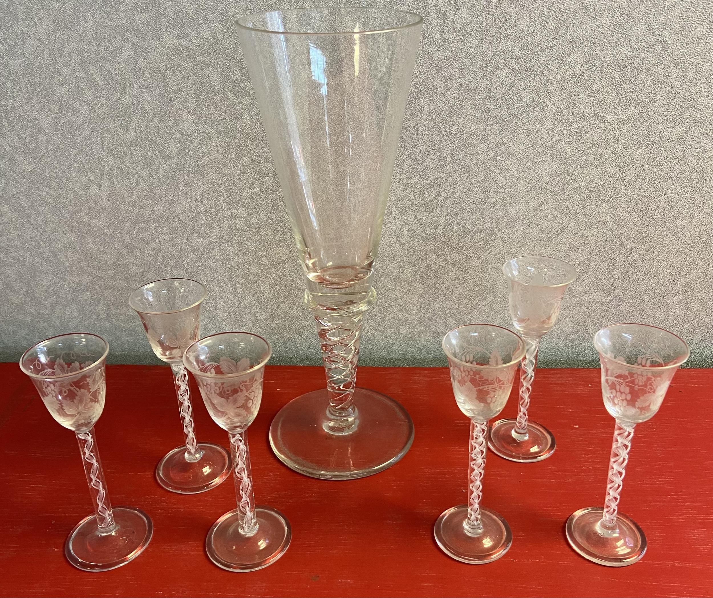 A Set of 6 twist stem free blown sherry glasses, etched with grape vines, Together with a large