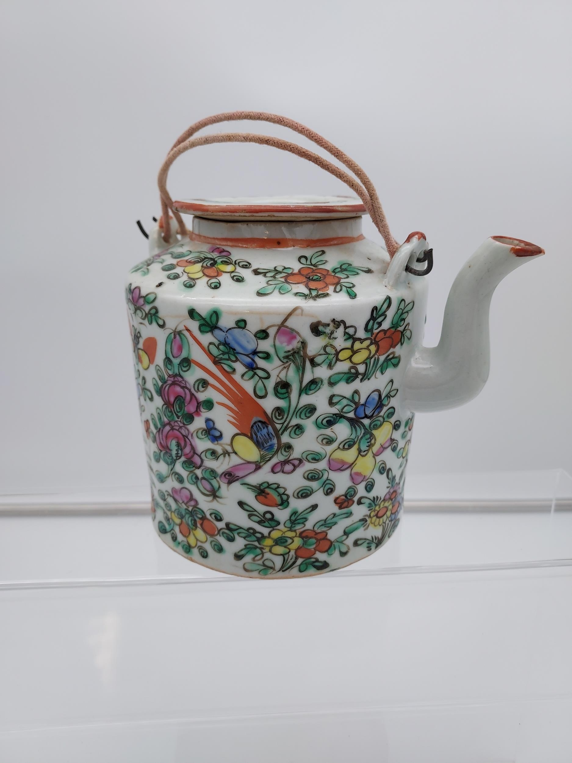 An Antique Chinese Canton pale green glazed and hand painted tea pot/ saki pot. With wire handle. [