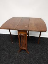 An antique mahogany Sutherland drop leaf table, supported on twin pierced supports [64x60x77cm]