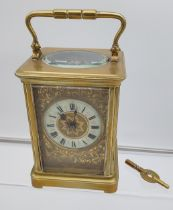 Antique Brass cased and bevel glass carriage clock. Designed with an enamel dial. In a working