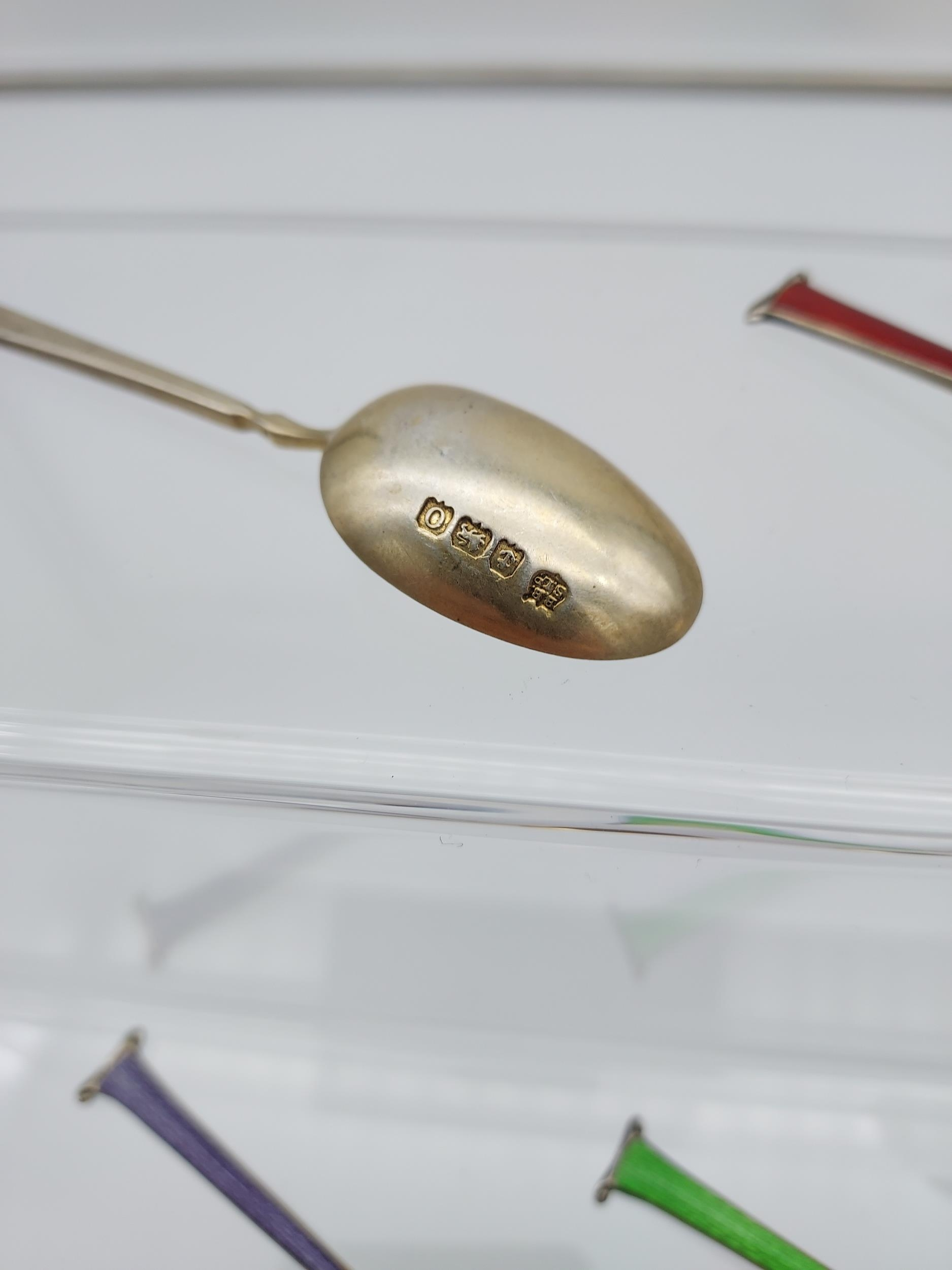 A Set of 11 Birmingham silver and enamel tea spoons. Makers Barker Brothers Silver Ltd. - Image 3 of 4