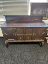 An oak sideboard with raised back detailed with twist and bead decoration