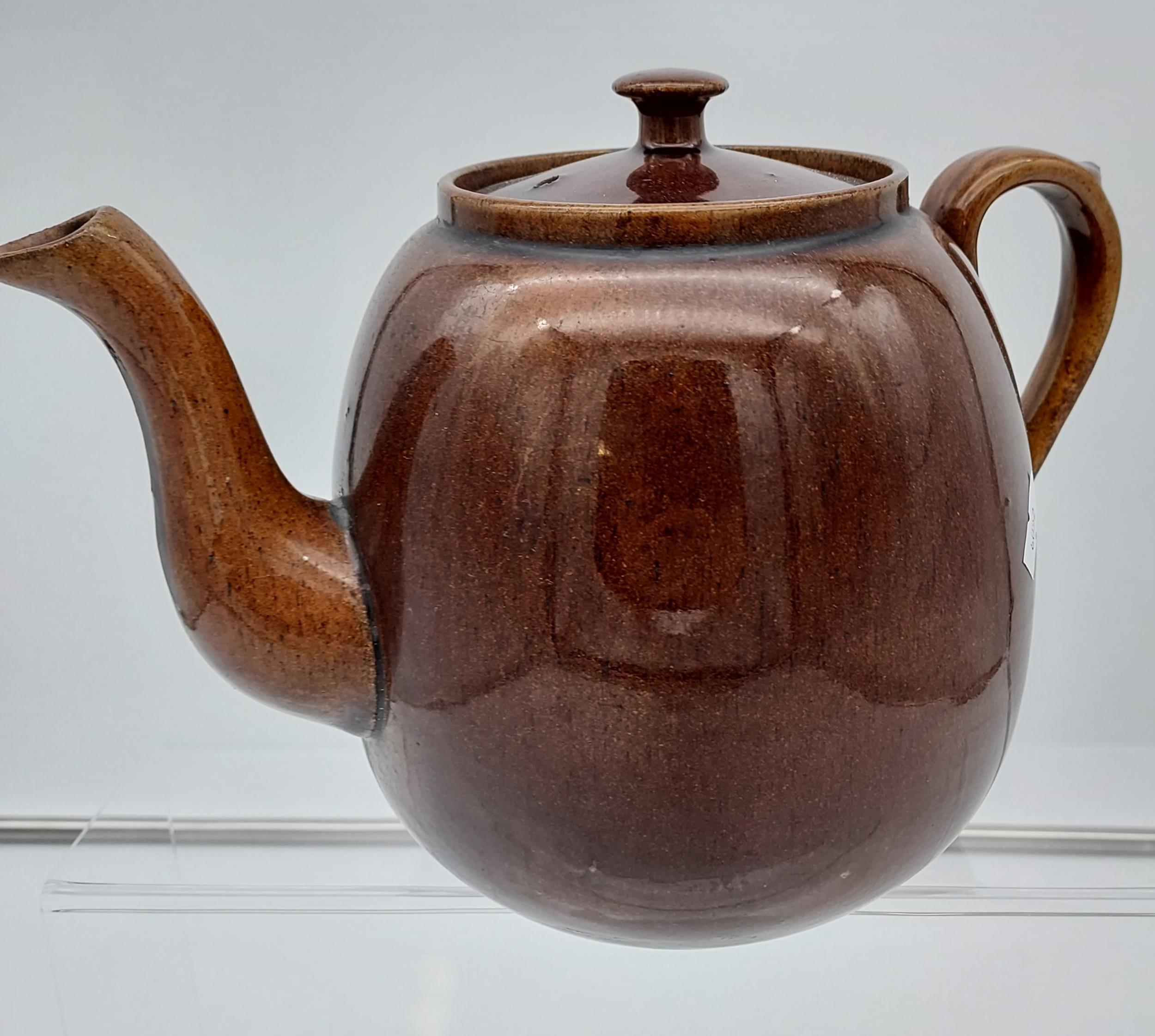 A Scottish brown glaze tea pot. [19cm in height]