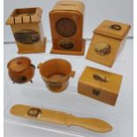 A Collection of 7 various Mauchline ware items to include page turner, Clock shaped bank, Ink
