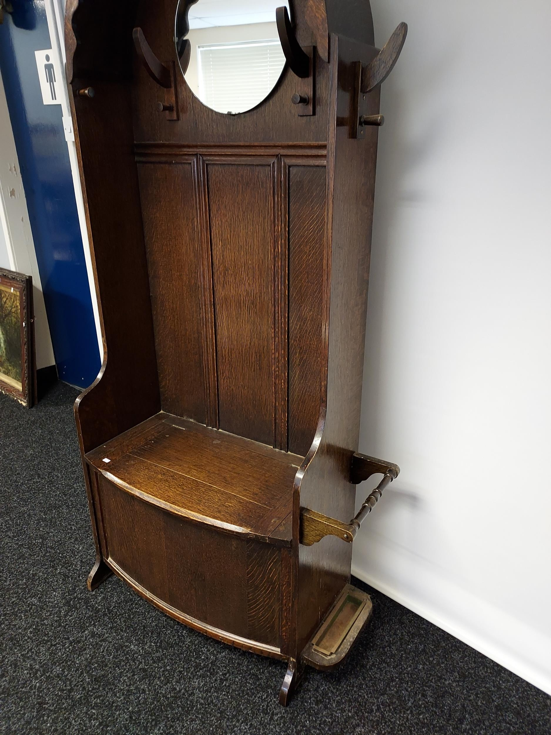 A nice example of an Art Deco oak, hall coat stand. Designed with a circular mirror, and lift up - Image 2 of 6