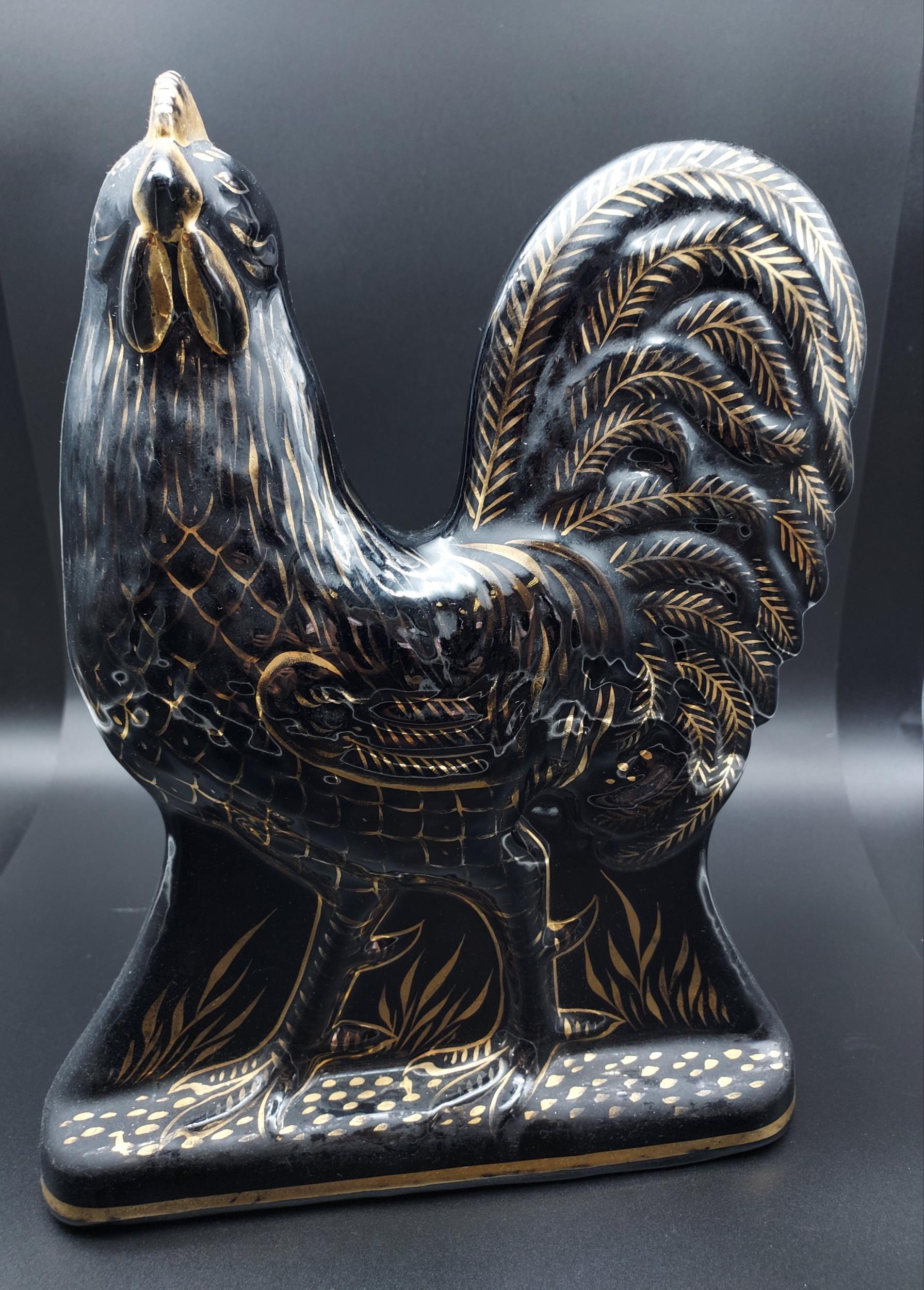 A Bo'ness pottery black lustre cockerel figurine. [31cm in height]