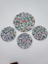 A Lot of four Chinese Qianlong marked hand painted floral design plates.